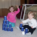 Rose and Jack play with paper cups